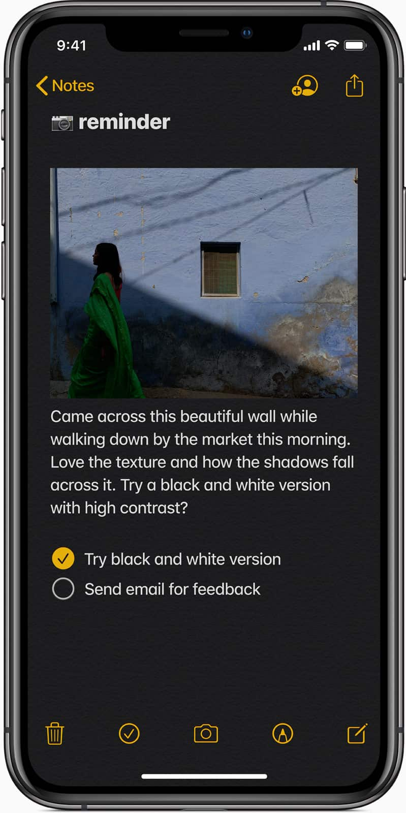 An iPhone Note in Dark Mode, with an option to send an email notification directly from the Note.