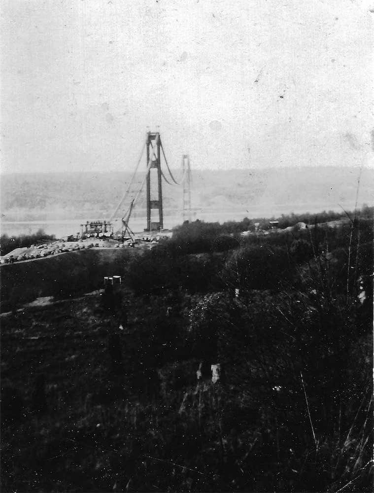 An 82 year old small (2 inches across) snapshot of the original Tacoma Narrows bridge during its construction. Photo by Viola Lemley.